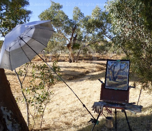 Painting on location photograph with umbrella and pochade